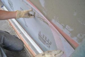 Colocación de malla con mortero fachada